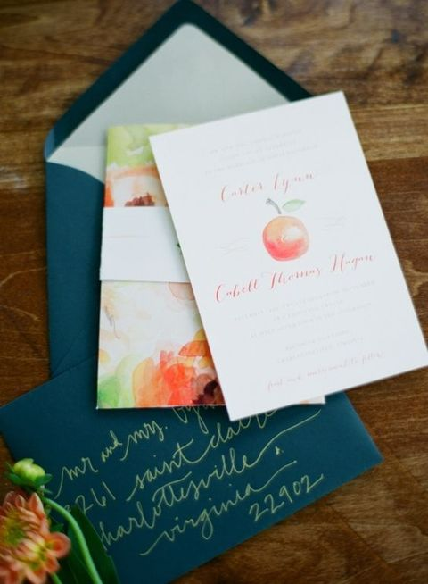emerald envelopes and watercolor apple and floral print invitations