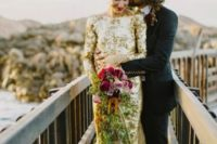 14 gold sequin long sleeve wedding dress with a bateau neckline