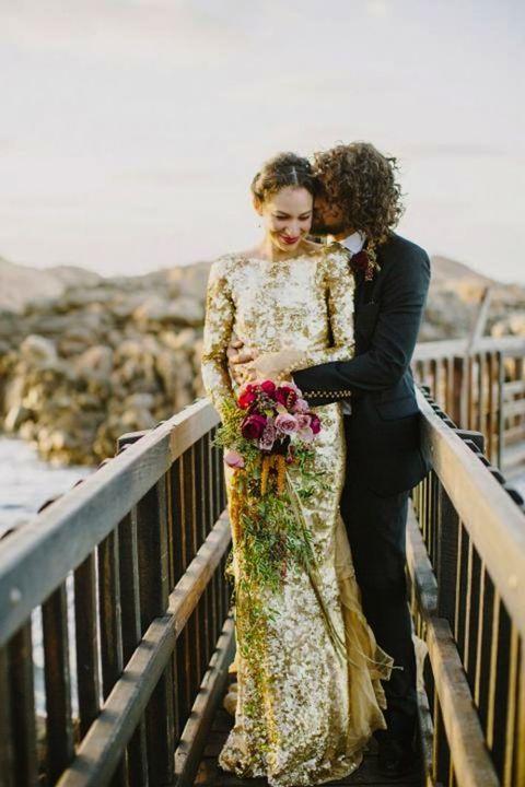 gold sequin long sleeve wedding dress with a bateau neckline