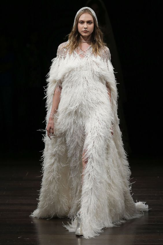 full feather wedding dress with short sleeves and embellishments for a winter look