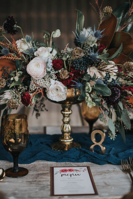 a gold flower vase, table number and flatware will effortlessly add chic to your table setting