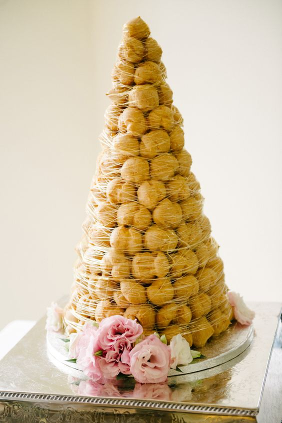 a traditional croquembouche with caramel cover is a spectacular alternative to a usual cake