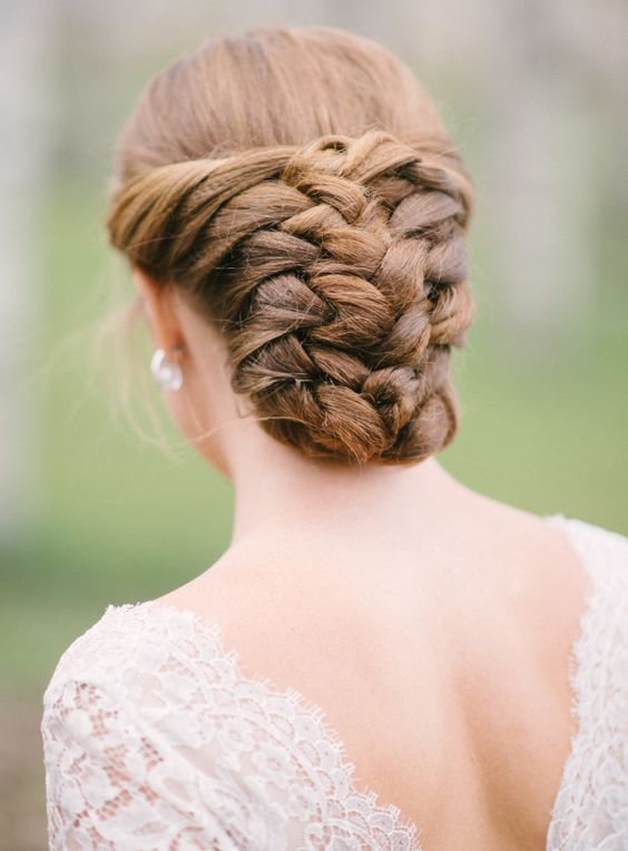 braided low bun hairstyle with a volume looks very unusual and non-traditional