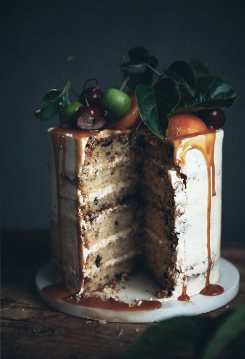 chocolate chip wedding cake with caramel and bourbon drip, fresh apples and cherries