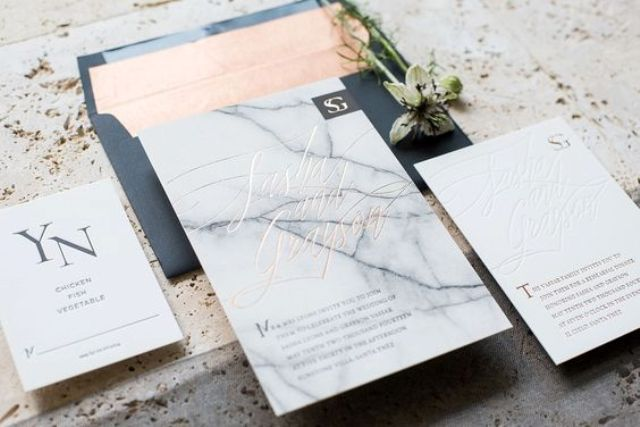 marble wedding invitations in black and orange envelopes