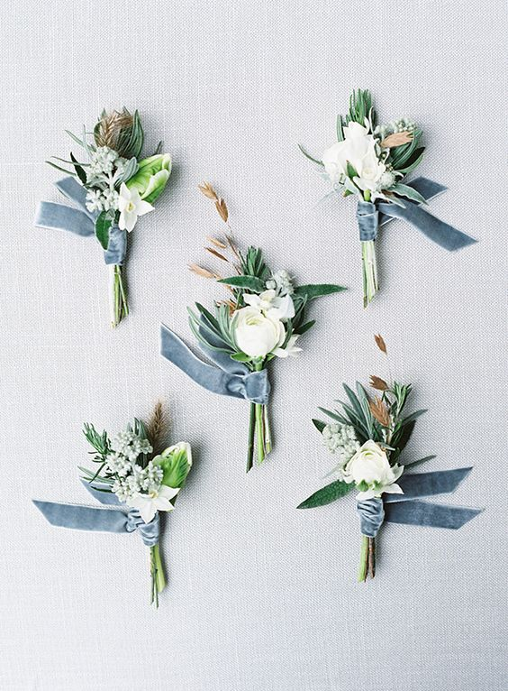 neutral floral boutonnieres with dusty blue velvet ribbon