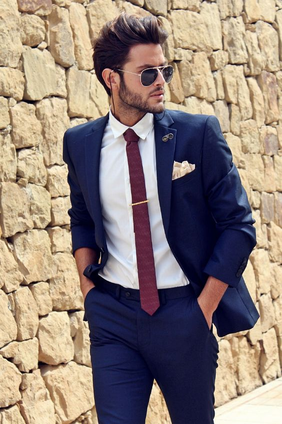 cobalt blue wedding suit with a white shirt and a red tie for a contrasting look