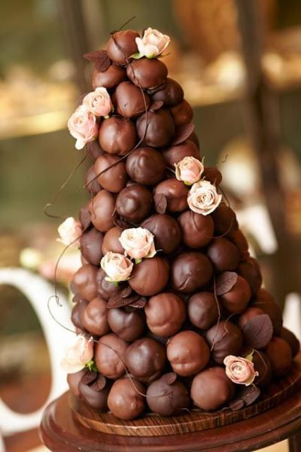 decadent chocolate cover croquembouche with fresh blush roses