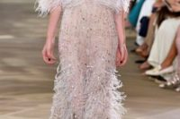 17 sparkling semi sheer wedding gown with crystals and a feather skirt, bodice and sleeves by Monique Lhuillier