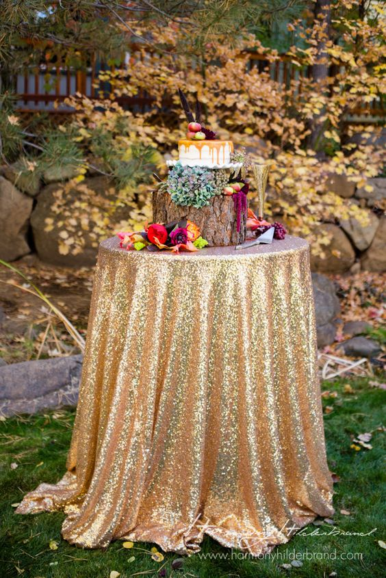 a gold sequin tablecloth for a fall cake table