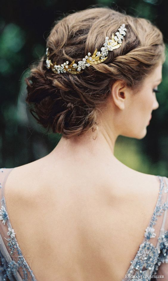 curly bridal updo with a rhinestone and gold hair vine as a trendy accessory