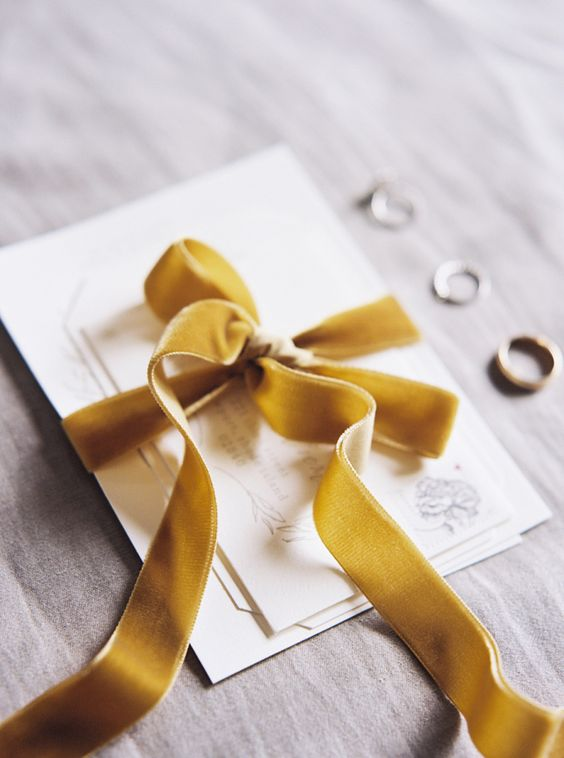 mustard-colored velvet ribbon tied invitation suite