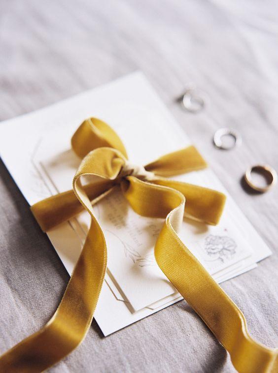 mustard-colored velvet ribbon tied invitation suite