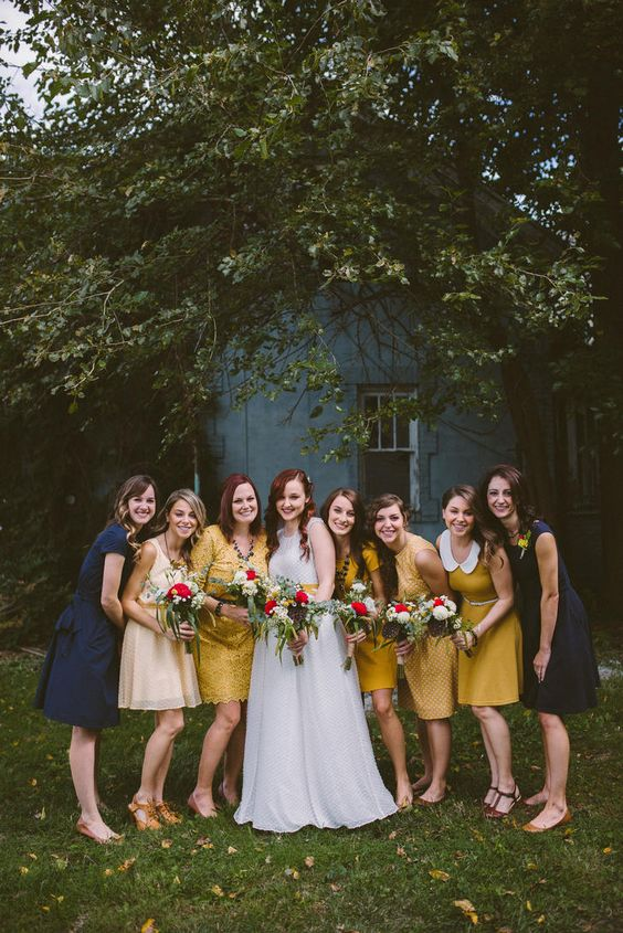 navy and mustard mismatching bridesmaids' dresses