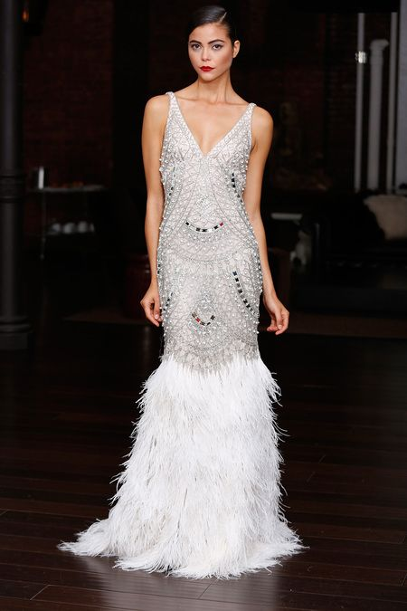 sleeveless silver V neckline heavily embellished wedding dress with a feather skirt