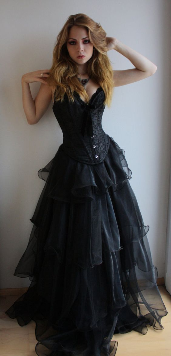 strapless corset wedding dress with a velvet bow and a ruffled skirt for a steampunk bride