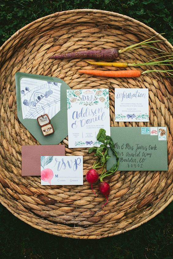 watercolor print wedding invitations in muted colors with green envelopes