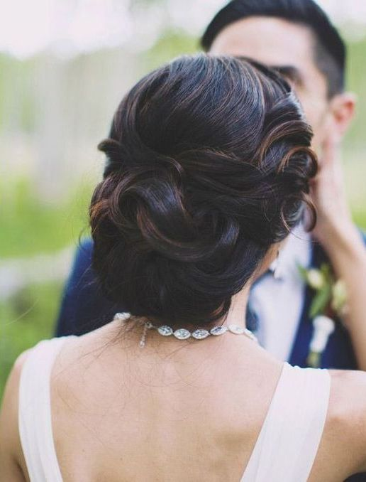 elegant curled wedding updo with a volume and in fall shades looks wow
