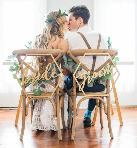 honeycomb wedding chair signs and eucalyptus for decor