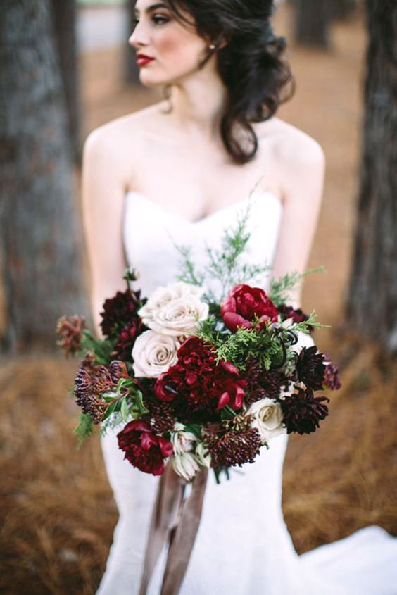 red, burgundy and a dark purple wedding bouquet