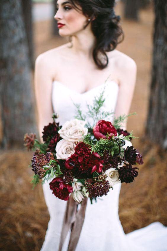 red, burgundy and a dark purple wedding bouquet