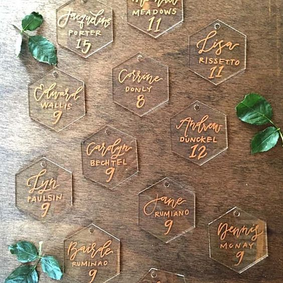 2 acrylic hexagon place cards with calligraphy