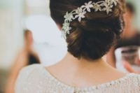 20 elegant twisted low bun with a sparkling flower hairpiece