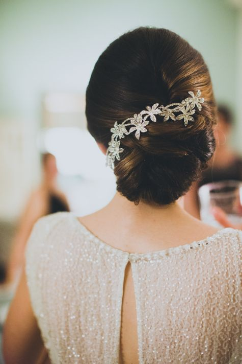 elegant twisted low bun with a sparkling flower hairpiece