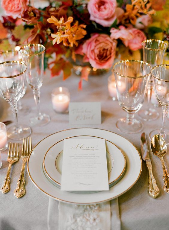 gilded edge glasses, plates and flatware for an elegant look