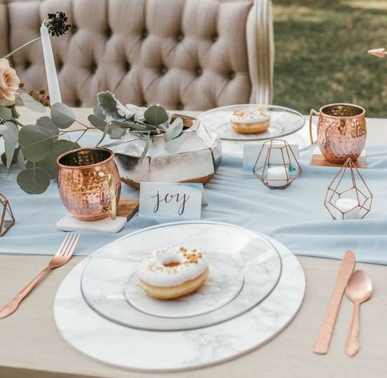 marble chargers and vases will easily make any wedding table elegant and chic