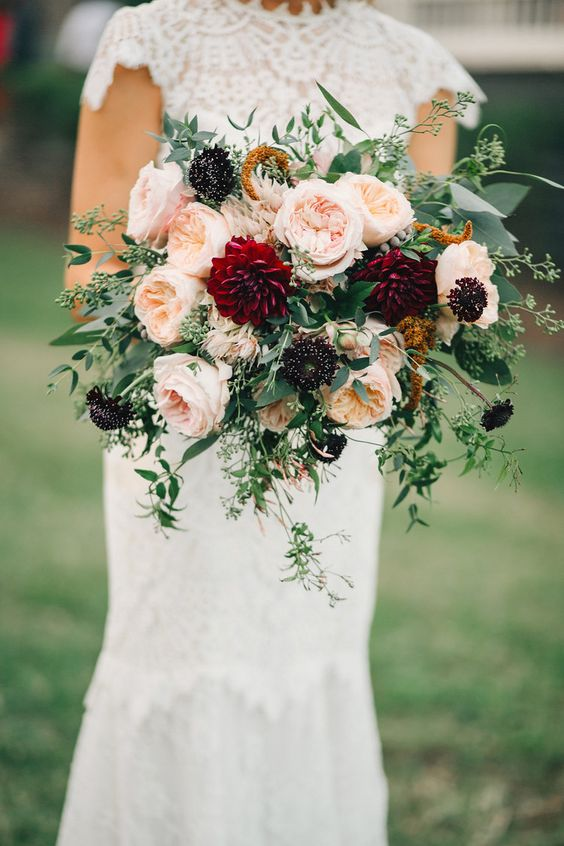 organic bridal bouquet with burgundy dahlias, peach garden roses, and trailing greenery