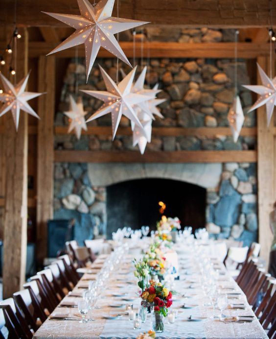 shining white star-shaped lamps over the reception