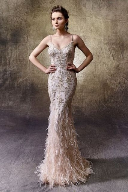 blush spaghetti strap fitting wedding dress with gold embroidery and a feather skirt