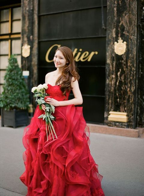 strapless red wedding dress with a ruffled skirt by Vera Wang