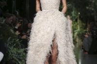 22 beautiful ostric feather off the shoulder blush wedding dress witih a high front slit  and a sparkling bodice
