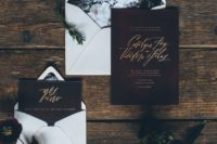 22 black floral lining envelopes and burgundy and gold calligraphy invites