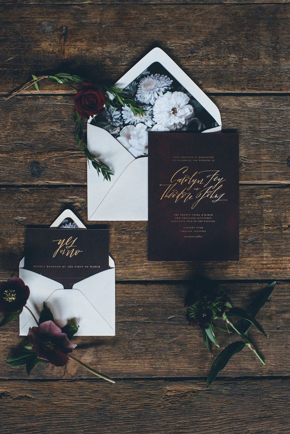 black floral lining envelopes and burgundy and gold calligraphy invites