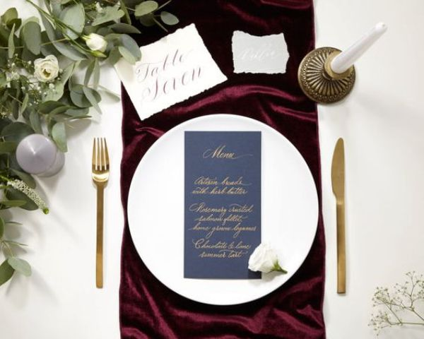 burgundy fabric for accentuating each setting