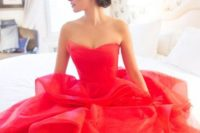 22 strapless red ballgown with a ruffled skirt for a bold statement