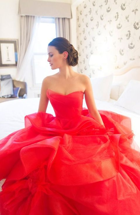 strapless red ballgown with a ruffled skirt for a bold statement