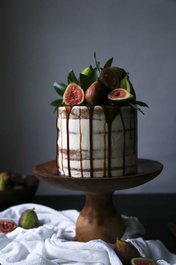 semi naked wedding cake with chocolate drip, fresh figs and leaves