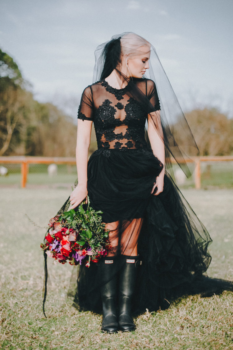 short sleeve illusion black lace applique bodice wedding dress with a layered tulle skirt and a long veil