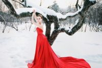 23 strapless hot red draped wedding dress with a long train and a button row on the back