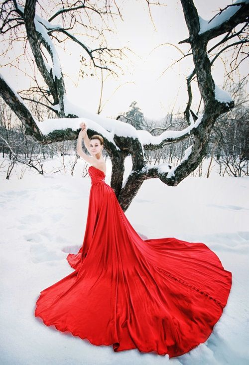 strapless hot red draped wedding dress with a long train and a button row on the back
