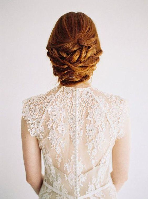 twisted and braided sleek low updo without accessories is a chic casual idea