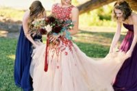 24 burgundy lace applique wedding dress with a sleeveless bodice and a tulle full skirt
