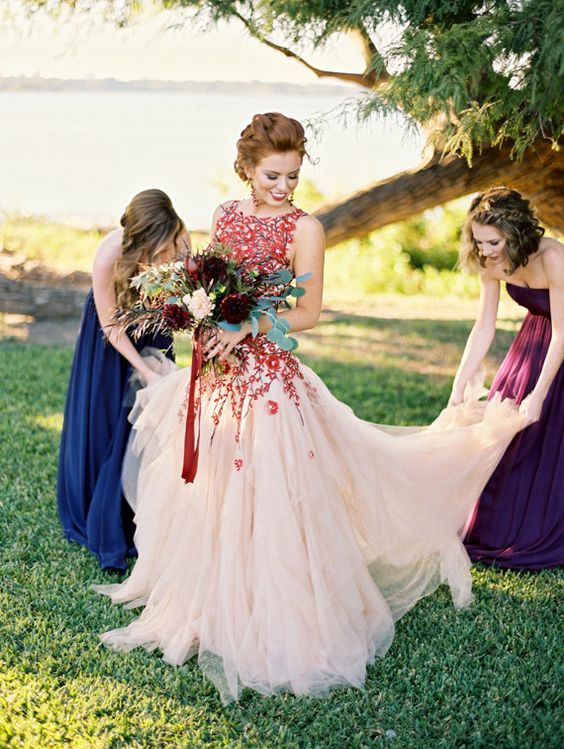burgundy lace applique wedding dress with a sleeveless bodice and a tulle full skirt