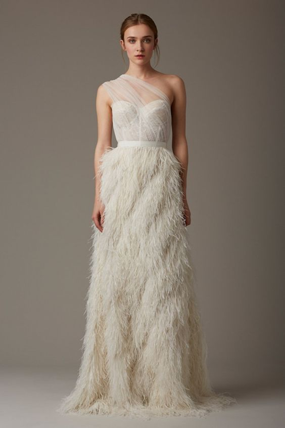 ivory wedding dress with an illusion neckline and one shoulder tulle part and a feather skirt