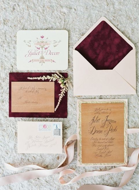 neutral invitations and burgundy lining envelopes, floral prints