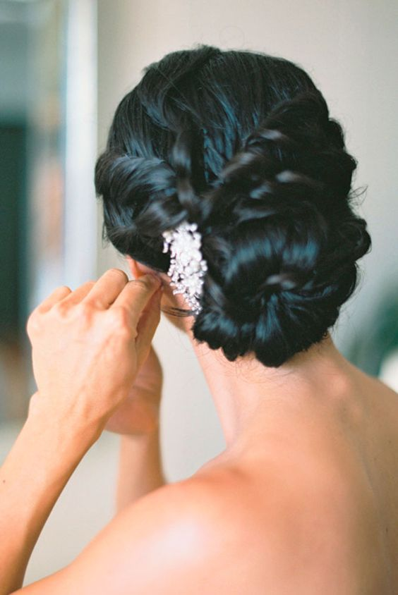twisted low bun with a rhinestone hairpiece on one side